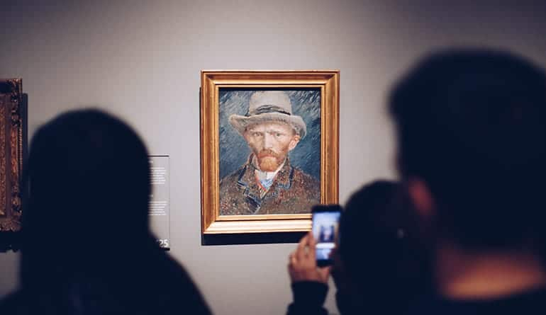 People taking a photo of a Van Gough.